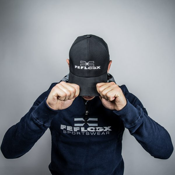 FEFLOGX Sportswear 1/4-Zip-Sweater, Action-Bild (2).