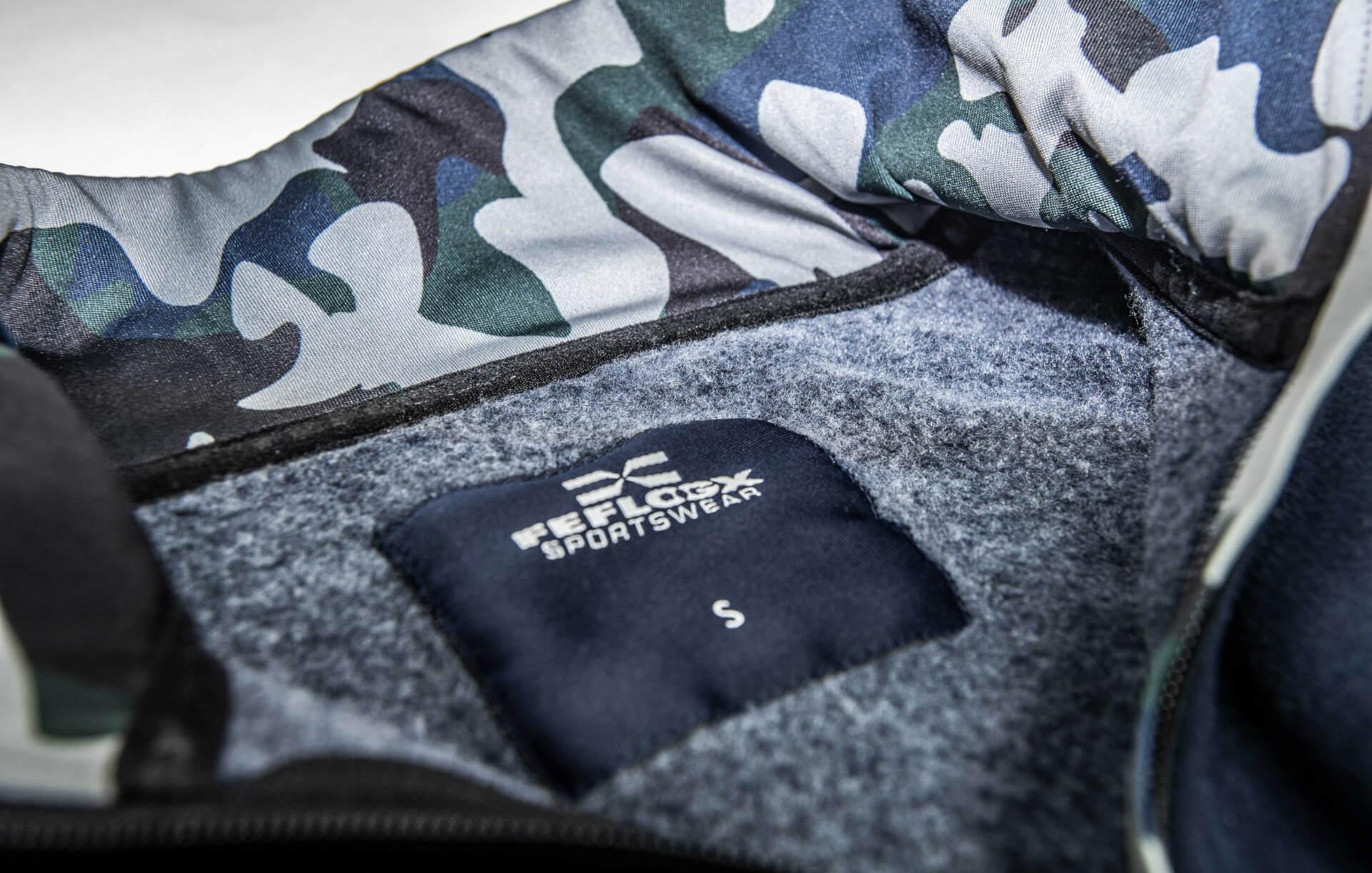 FEFLOGX Sportswear ein-viertel-Zip-Sweater, Nack-Tag Detail.