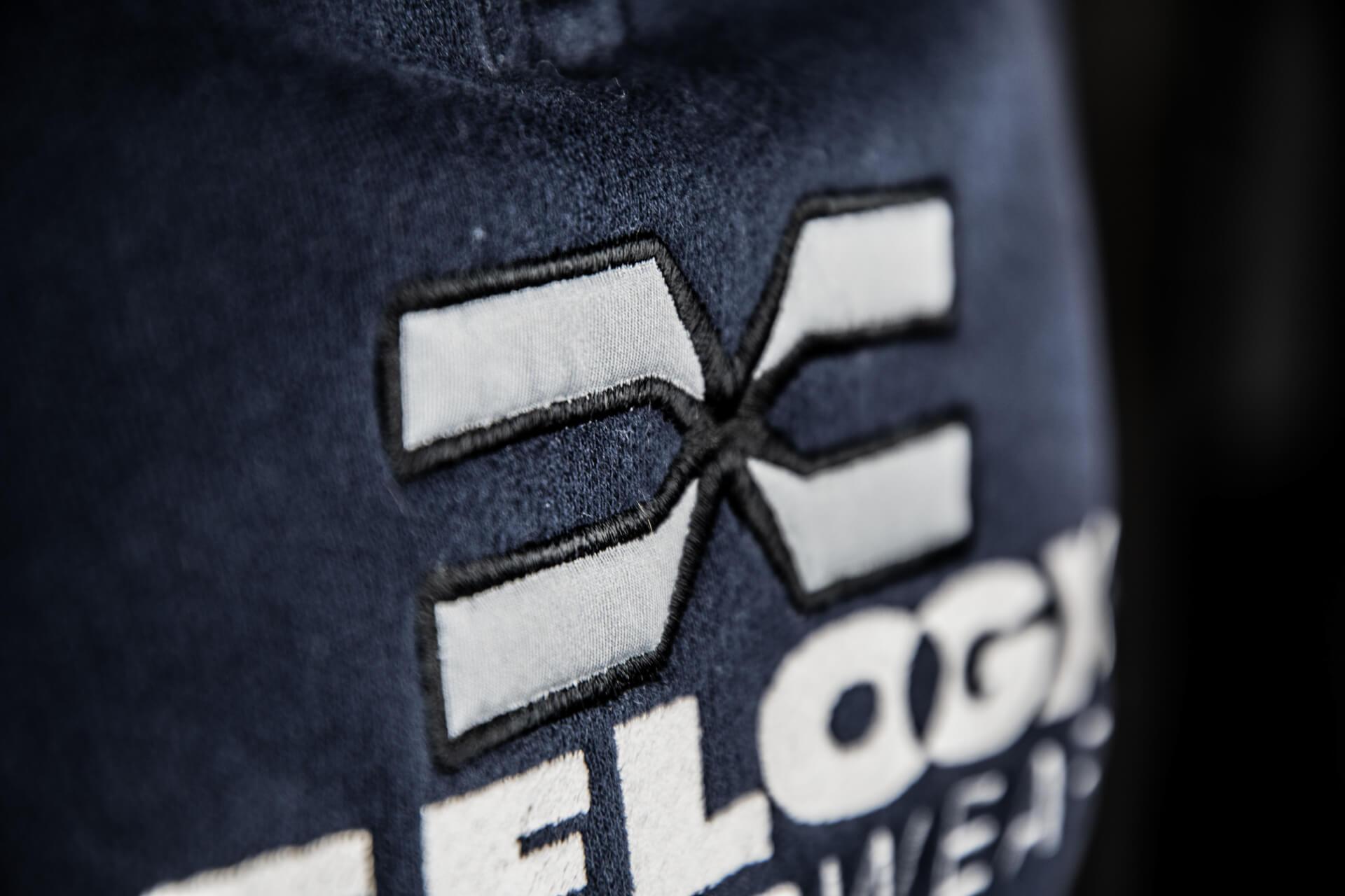 FEFLOGX Sportswear ein-viertel-Zip-Sweater, Logo Stick Detail.